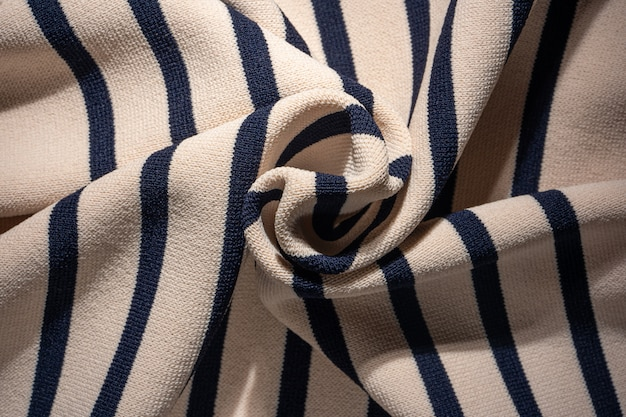 Twisted striped knit fabric background