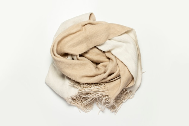 Twisted woolen scarf on a white background.