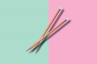 Two a pencil on colore background