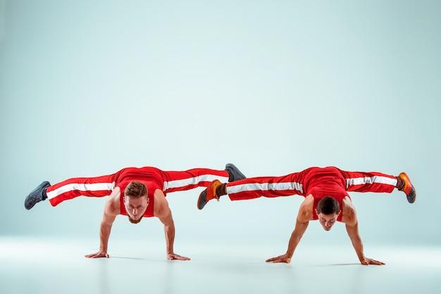 The two acrobatic men on balance pose