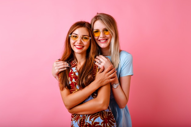Two adorable happy young women having fun together