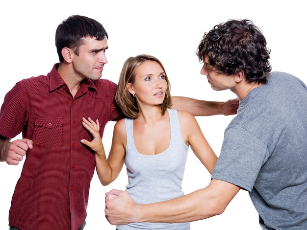 Two agressive men fight for the woman - isolated over white background