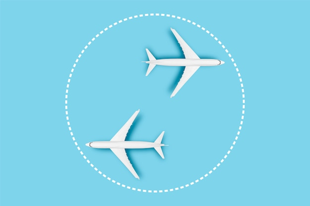 Two airplanes on a blue background. concept travel, airline tickets, flight, pallet route, transfer.