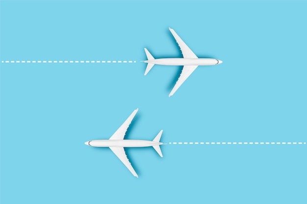 Two airplanes and a line indicating the route on a blue background. concept travel, airline tickets, flight, route pallet.