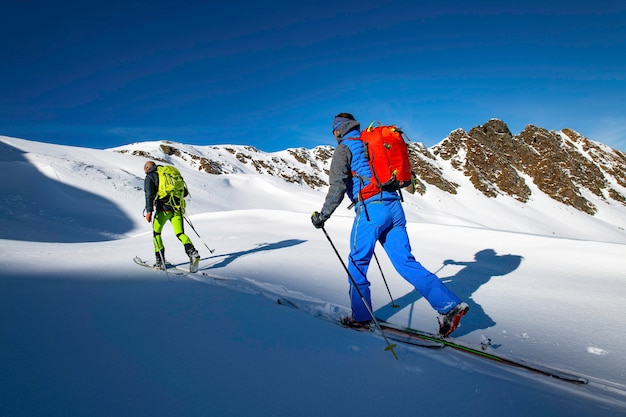 Two alpinist skiers during a ski mountaineering trip
