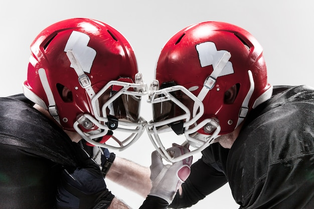 The two american football players fighting on white background