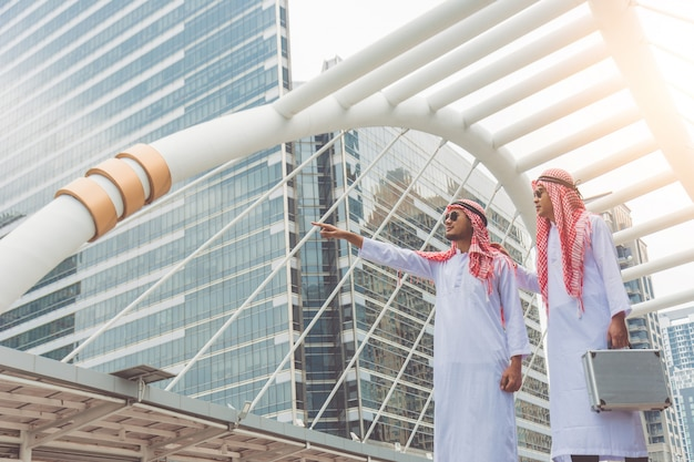Two arab businessmen are exploring investment locations, planning new business projects.