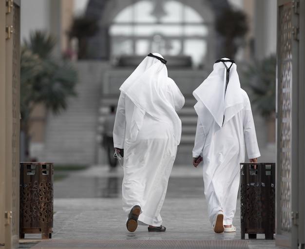 Two arab men walking in the city