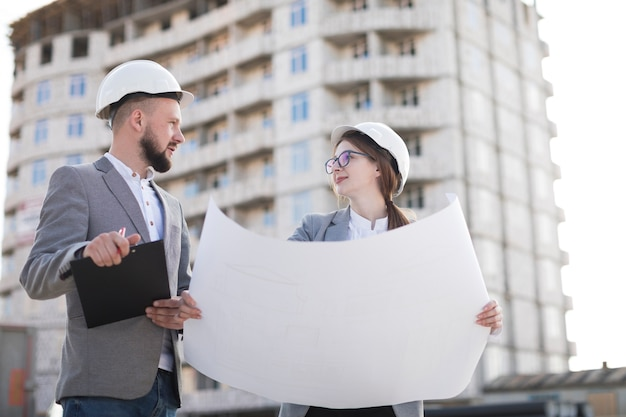 Two architect working together on architectural project at architectural project