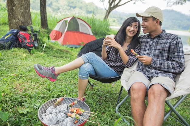 Two asian couple in nature camping