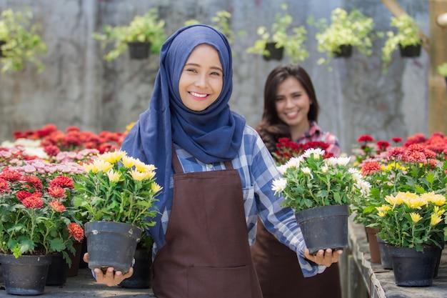 Two asian florist in flower shop