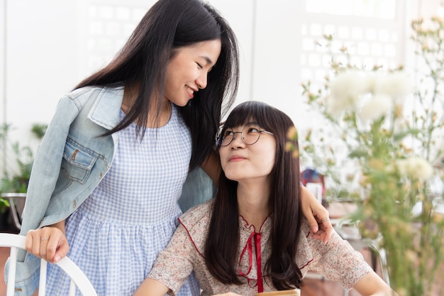 Two asian girl teen love together look at each other friendship or lesbian concept.