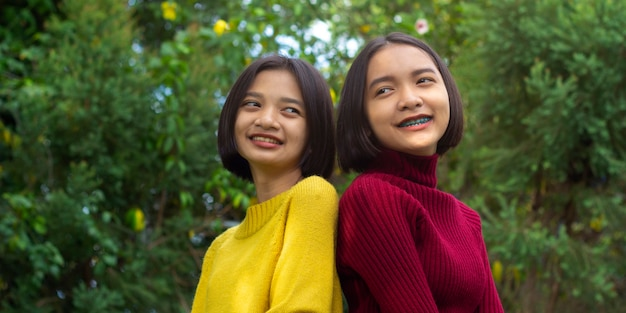 Two asian happy young girls in nature