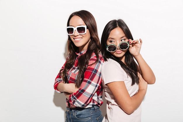 Two asian pretty cute ladies sisters