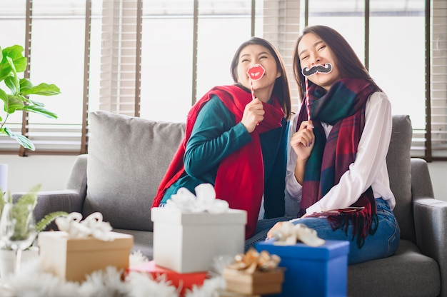 Two asian women best friends having fun together during new year