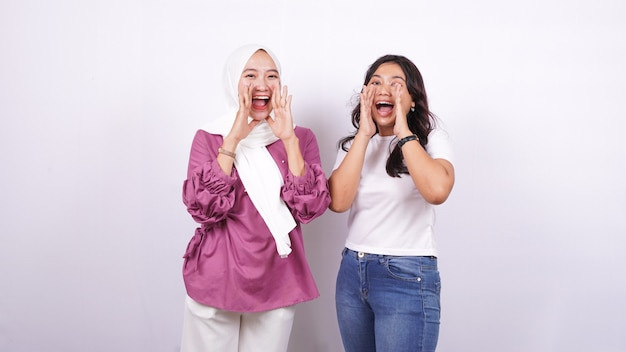 Two asian women screaming expressions isolated white surface