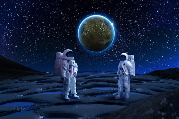 Two astronaut on rock surface with world background the image of astronauts