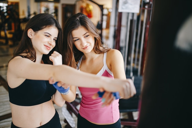 Two athletic girls in the gym