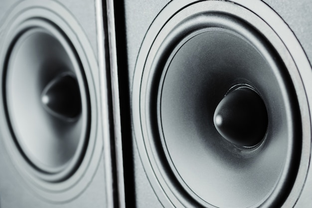 Two audio sound speakers on dark background, close up