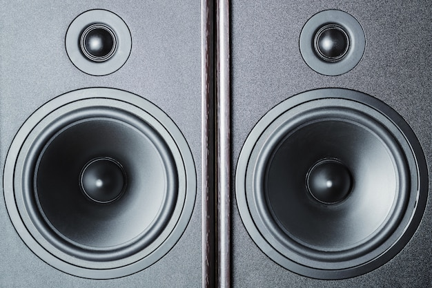Two audio sound speakers on dark, close up