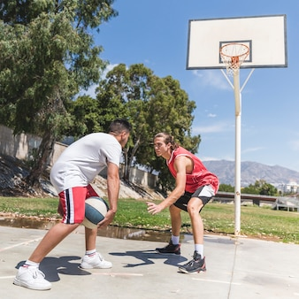 Two basketball player on outdoors court
