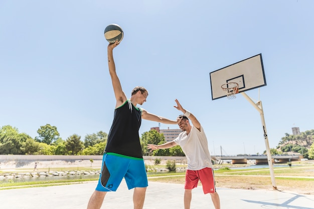 Two basketball player practicing on outdoors court
