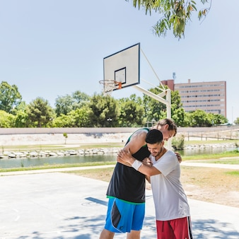Two basketball players having a sports greeting before training