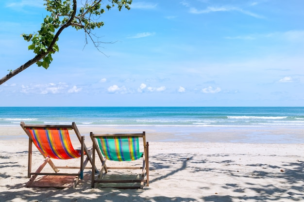 Two beach chairs on the sandy beach near the sea at koh chang thailand.