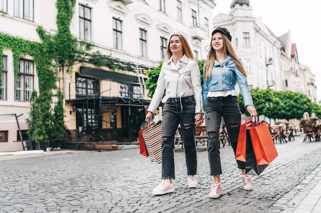 Two beautiful blonde women, mom and daughter, walking the streets of the city