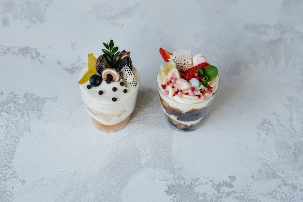 Two beautiful and delicious trifle cakes close-up on a light surface. dessert, healthy food.