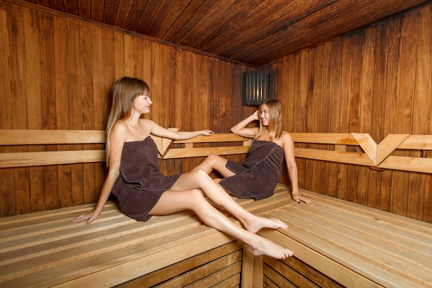 Two beautiful females in sauna.