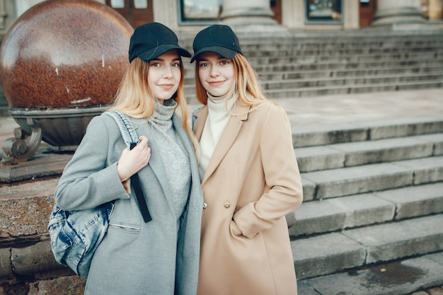Two beautiful girls in a city