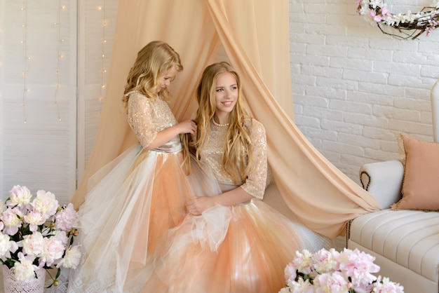 Two beautiful girls with a beautiful dresses