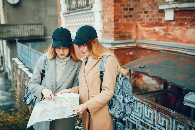Two beautiful girls with a map