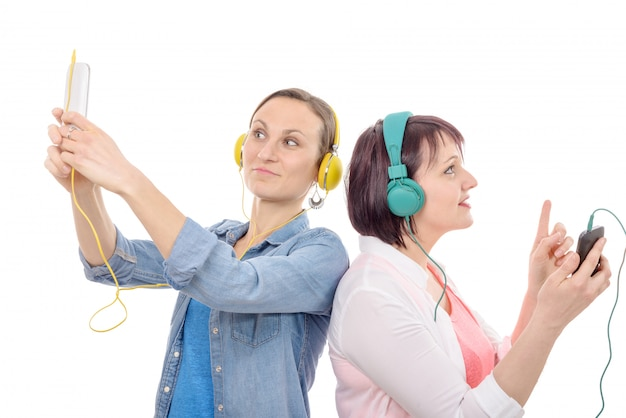 Two beautiful women listening to music with phone