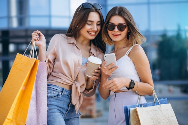 Two beautiful women shopping in town