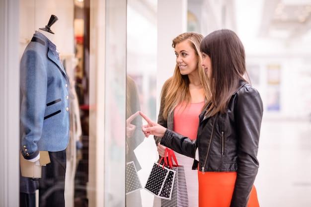 Two beautiful women window shopping