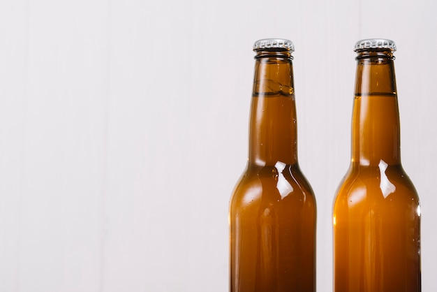 Two beer bottles on white background