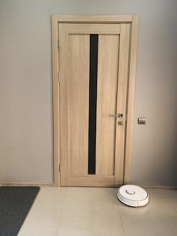 Two beige door to bedroom at home.
