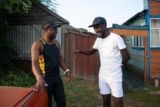 Two black guys joke and have fun o