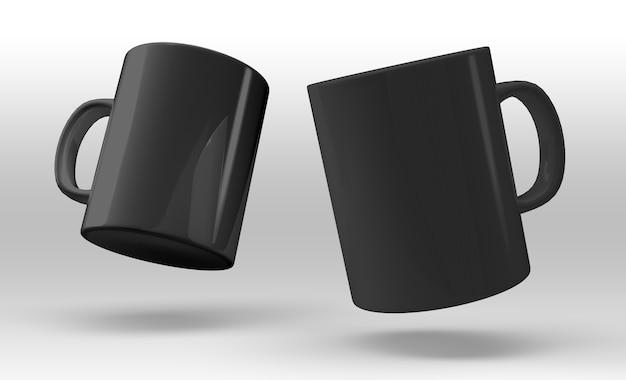 白い背景の上の2つの黒いマグカップ