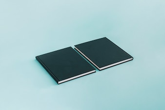 Two black notebooks