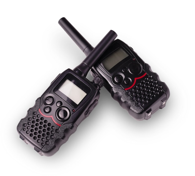 Two black walkie-talkie antennas and indicators carved on a white surface