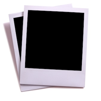 Two blank instant camera photo prints isolated on white with shadow