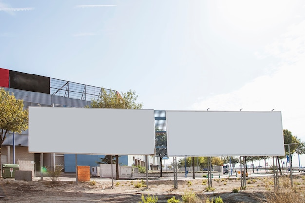 Two blank white billboards