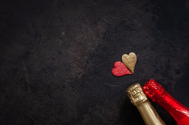 Two bottles of champagne two hearts