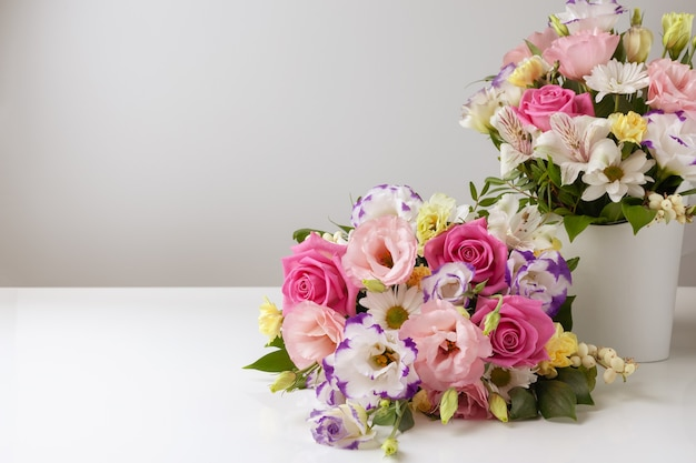 Two bouquets of different sizes of roses, daisies, lisianthus, chrysanthemums