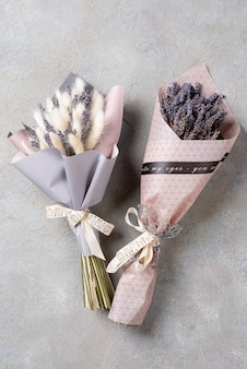 Two bouquets of lavender and lagurus in the package