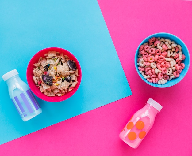 Two bowls of cereals with milk on table