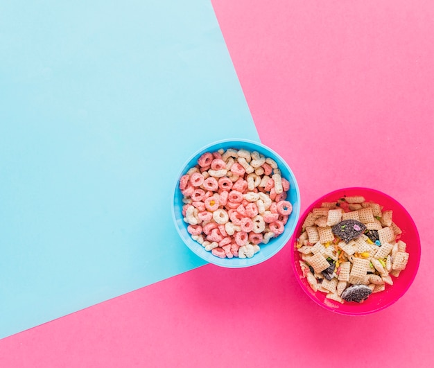 Two bowls with cereals on table